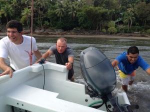 Pushing the boat in Drake Bay