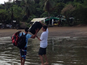 Tiron with luggage at beach on Osa